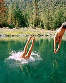 USA, California, man and woman diving into Salmon River, Forks of Salmon, Otter Bar Kayaking School