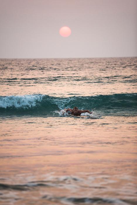 Surfing at sunset at Paradise Beach (Sar Sar Aw Beach), Dawei Peninsula, Tanintharyi Region, Myanmar (Burma)