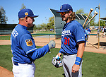 Los Angeles Dodgers' D.J. Peters works with minors coach John Shoemaker before a spring training game in Glendale, Ariz., on Friday, March 24, 2017.<br /> Photo by Cathleen Allison/Nevada Photo Source