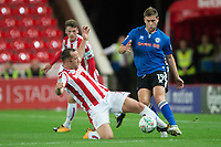 Steven Davies of Rochdale is tackled by Charlie Adam of Stoke City during the Carabao Cup match between Stoke City and Rochdale at the Bet365 Stadium, Stoke-on-Trent, England on 23 August 2017. Photo by James Williamson / PRiME Media Images.