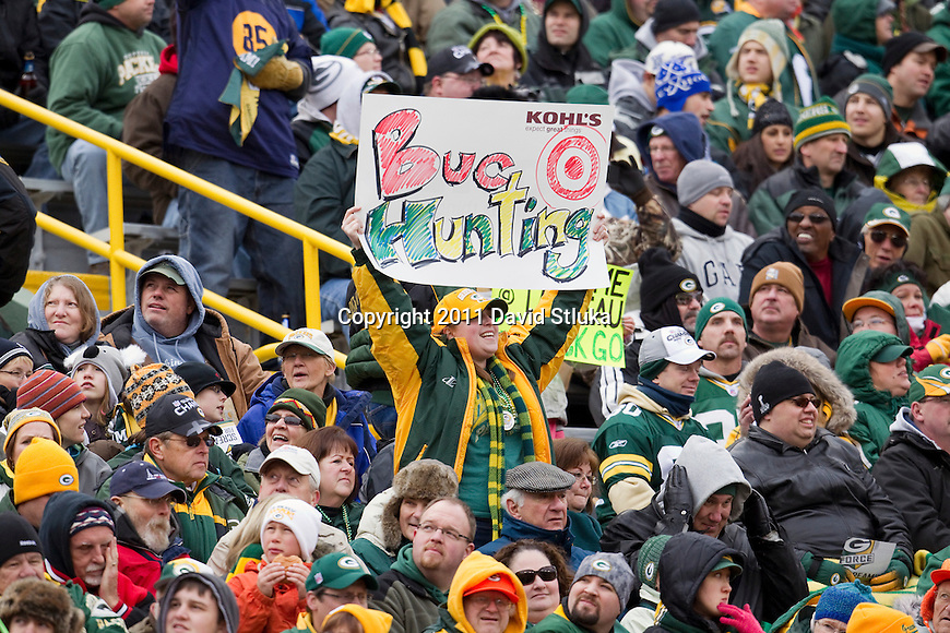 Green Bay Packers fan holds up a sign during a Week 11 NFL football game against the Tampa Bay Buccaneers on November 20, 2011 in Green Bay, Wisconsin. The Packers won 35-26. (AP Photo/David Stluka)