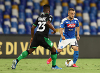 25th July 2020; Stadio San Paolo, Naples, Campania, Italy; Serie A Football, Napoli versus Sassuolo; Stanislav Lobotka of Napoli takes on Hamed Junior Traorè of Sassuolo