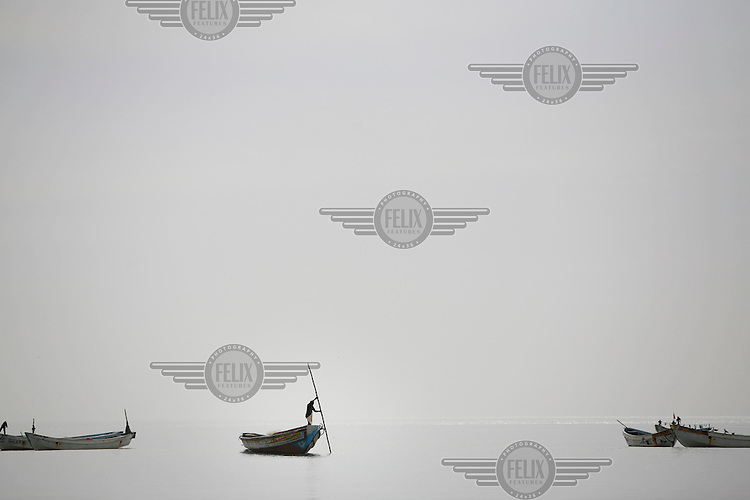A fisherman works near the village of Gunjur.