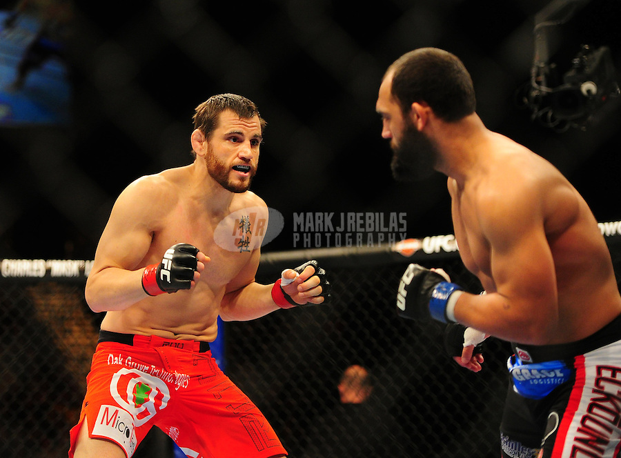 Dec 30, 2011; Las Vegas, NV, USA; UFC fighter Jon Fitch (left) against Johny Hendricks during a welterweight bout at UFC 141 at the MGM Grand Garden event center. Mandatory Credit: Mark J. Rebilas-