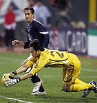 10 February 2006: Japan goalkeeper Yoshikatsu Kawaguchi (in yellow) pounces on the ball before US forward Josh Wolff (in blue) can react. The United States Men's National Team defeated Japan 3-2 at SBC Park in San Francisco, California in an International Friendly soccer match.