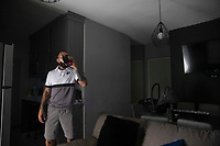 HERMOSILLO, MEXICO - MAY 08: Oscar Rai Villa de los Reyes footballer of the Cimarrones De Sonora takes a breather and drinks water, during cardiovascular exercises that he performs at home in the middle of the Coronavirus pandemic on May 8, 2020 in Hermosillo, Mexico. Due to the Coronavirus crisis the Liga MX has announced the cancellation of the Ascenso MX 2019-2020 season and to temporarily suspend promotions and relegations for the next six seasons. (Photo by Luis Gutierrez/Norte Photo/Getty Images)