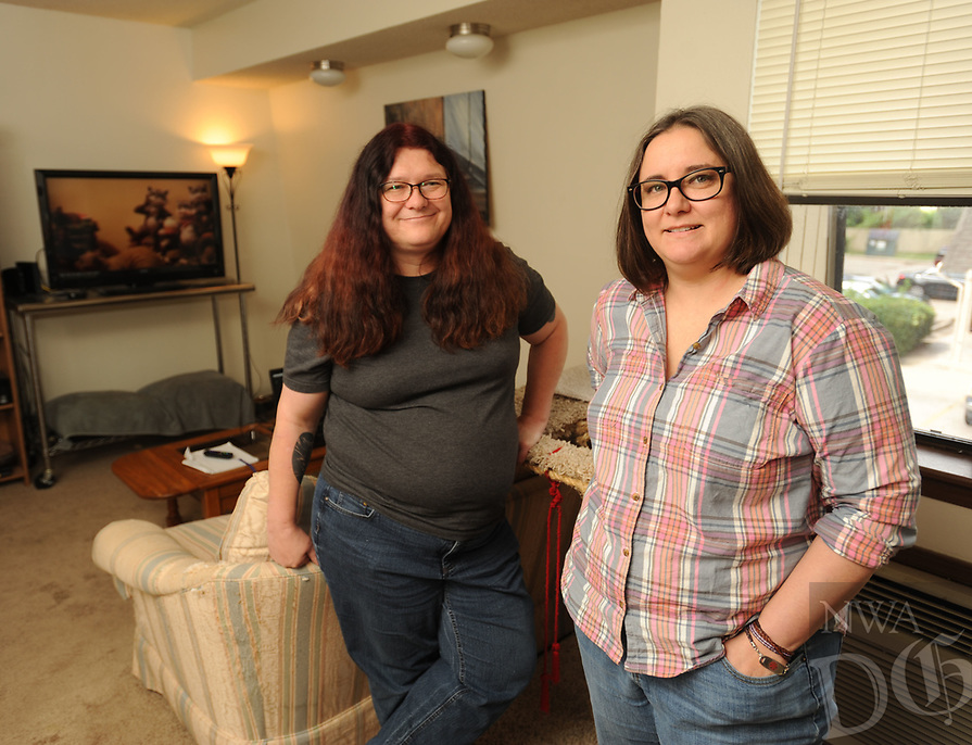 NWA Democrat-Gazette/ANDY SHUPE<br /> Friends Eris (left) and Stephanie Lewis speak Thursday, July 6, 2017, in Lewis' living room of her Springdale apartment after the two completed work on a feature-length documentary film about Lewis' aunt, who is a miniatures artist.
