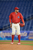 Clearwater Threshers relief pitcher Alexis Rivero (16) looks in for the sign during a game against the Dunedin Blue Jays on April 6, 2018 at Spectrum Field in Clearwater, Florida.  Clearwater defeated Dunedin 8-0.  (Mike Janes/Four Seam Images)