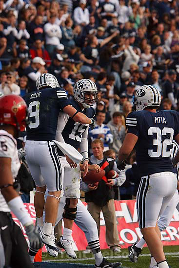 Provo - BYU WR Austin Collie (9) and BYU QB Max Hall (15) celebrate Collie's 4th quarter touchdown, bring the score in BYU's favor to 41-6. BYU vs. San Diego State University college football, Saturday, November 8, 2008 at LaVell Edwards Stadium. BYU wins 41-12..