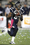 Nevada's Aaron Bradley (81) scores the game-winning touchdown in overtime against Wyoming during the second half of an NCAA college football game in Reno, Nev., on Saturday, Oct. 6, 2012. Nevada won 35-28 in overtime.(AP Photo/Cathleen Allison)