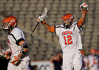 John Haldy (12) of Virginia celebrates a goal during the ACC men's lacrosse tournament semifinals in College Park, MD.  Virginia defeated Duke, 16-12.