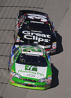 Nov. 7, 2009; Fort Worth, TX, USA; NASCAR Nationwide Series driver Casey MEars (29) leads Jason Leffler during the O'Reilly Challenge at the Texas Motor Speedway. Mandatory Credit: Mark J. Rebilas-