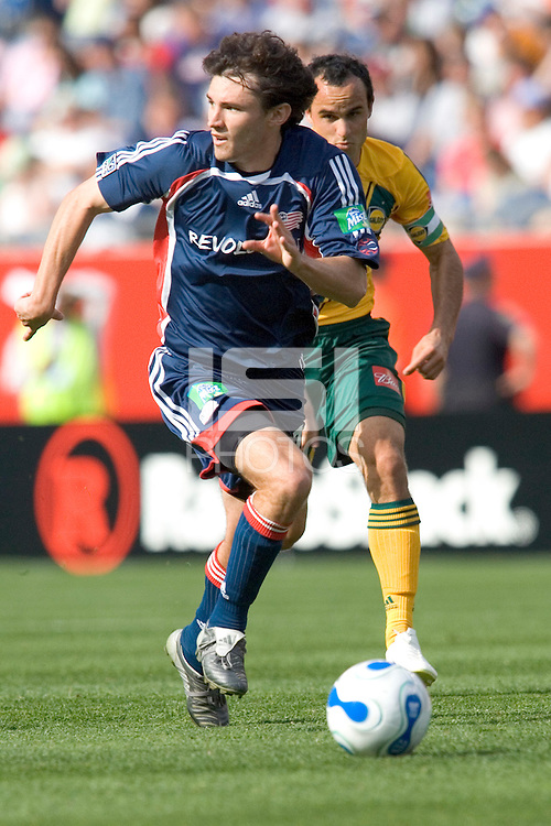 The New England Revolution's Michael Parkhurst  is chased by Landon Donovan of the LA Galaxy. The New England Revolution defeated the Los Angeles Galaxy, 4-0, on May 6 at Gillette Stadium, Foxborough, MA.