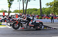 Jun. 1, 2014; Englishtown, NJ, USA; NHRA pro stock motorcycle rider Eddie Krawiec (near lane) races alongside teammate Andrew Hines during the Summernationals at Raceway Park. Mandatory Credit: Mark J. Rebilas-