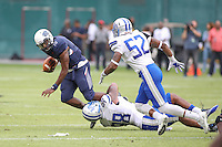 Washington, DC - September 16, 2016: Howard Bison quarterback Kalen Johnson (15) gets sacked during game between Hampton and Howard at  RFK Stadium in Washington, DC. September 16, 2016.  (Photo by Elliott Brown/Media Images International)