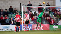Lincoln City's Grant Smith is beaten by a shot from Stevenage's Ilias Chair (out of picture) as he scores his side's first goal<br /> <br /> Photographer Chris Vaughan/CameraSport<br /> <br /> The EFL Sky Bet League Two - Lincoln City v Stevenage - Saturday 16th February 2019 - Sincil Bank - Lincoln<br /> <br /> World Copyright © 2019 CameraSport. All rights reserved. 43 Linden Ave. Countesthorpe. Leicester. England. LE8 5PG - Tel: +44 (0) 116 277 4147 - admin@camerasport.com - www.camerasport.com