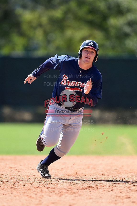 Atlanta Braves infielder Ian Hagenmiller (28) during a minor league spring training game against the Washington Nationals on March 26, 2014 at Wide World of Sports in Orlando, Florida.  (Mike Janes/Four Seam Images)