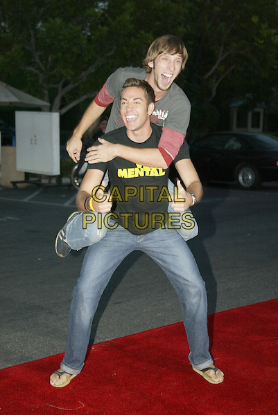 JOEL DAVID MOORE & ZACHARY LEVI.At 'Without A Paddle' World Premiere held at Paramount Pictures. Hollywood, CA, USA.August16, 2004.full length, piggy back, gesture, thumbs up, funny, very mental t-shirt, logo. slogan.www.capitalpictures.com.sales@capitalpictures.com.© 2004 by Charles Harris.