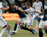 FOXBOROUGH, MA - JULY 27: Teal Bunbury #10 dribbles as Oriol Rosell #20 defends during a game between Orlando City SC and New England Revolution at Gillette Stadium on July 27, 2019 in Foxborough, Massachusetts.