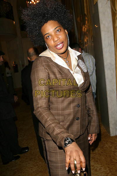 MACY GRAY.Tinseltown to Gotham Pre-Oscar Event held at the Regent Beverly Wilshire Hotel, Beverly Hills, California, USA..March 2nd, 2006.Photo: Zach Lipp/AdMedia/Capital Pictures.Ref: ZL/ADM.half length brown plaid jacket .www.capitalpictures.com.sales@capitalpictures.com.© Capital Pictures.