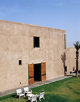 The small windows in this Marrakech house keep the light out and the house cool