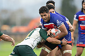 Sione Tuipulotu tries to break free from Penitoa Finau's tackle. Counties Manukau Premier Club Rugby game between Ardmore Marist and Manurewa, played at Bruce Pulman Park Papakura on Saturday May 12th 2018. Ardmore Marist won the game 20 - 3 after leading 17 - 3 at halftime.<br /> Ardmore Marist - Katetistoti Nginingini try, penalty try, Latiume Fosita conversion, Latiume Fosita 2 penalties.<br /> Manurewa - Logan Fonoti penalty.<br /> Photo by Richard Spranger.