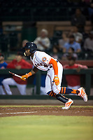 Scottsdale Scorpions center fielder Ronnie Dawson (4), of the Houston Astros organization, follows through on his swing after breaking his bat during an Arizona Fall League game against the Mesa Solar Sox on October 9, 2018 at Scottsdale Stadium in Scottsdale, Arizona. The Solar Sox defeated the Scorpions 4-3. (Zachary Lucy/Four Seam Images)
