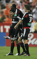 July 15, 2005: Washington, DC, USA:  DC United forward Jaime Moreno (99) celebrates his goal with teammates Bobby Boswell (32) and Freddy Adu (9) while playing the San Jose Earthquakes at RFK Stadium.  DC United won, 3-0.