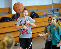 STAFF PHOTO BEN GOFF  @NWABenGoff -- 12/29/14 Kyle Ingram, 12, of Rogers passes the ball while playing in a pickup basketball game at the Rogers Activity Center in Rogers on Monday Dec. 29, 2014.