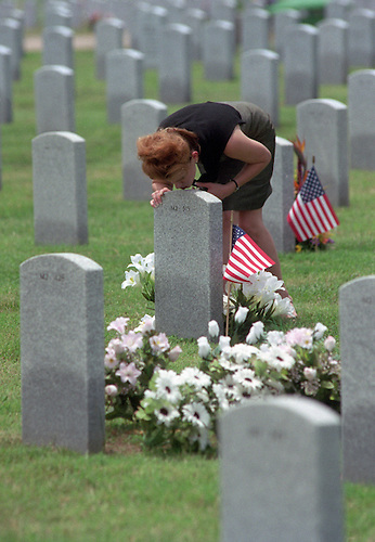 CONTACT FILED:  HOUSTON NATIONAL CEMETERY..5/27/01--Gigi Zientek leans over and kisses the grave of her father, Marion Patrick Zientek, who is buried at Houston National Cemetery on Veterans Memorial Drive. Marion Zientek was a Sp. 5 with the U.S. Army's combat engineers.     HOUCHRON CAPTION (05/28/2001):  Gigi Zientek kisses the marker on the grave of her father, Army veteran Marion Patrick Zientek, on Sunday at the Houston National Cemetery.  Memorial Day ceremonies will be held there today.