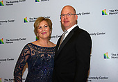 Deborah F. Rutter, President of the John F. Kennedy Center for the Performing Arts, and her husband, Peter Ellefson arrive for the formal Artist's Dinner honoring the recipients of the 42nd Annual Kennedy Center Honors at the United States Department of State in Washington, D.C. on Saturday, December 7, 2019. The 2019 honorees are: Earth, Wind & Fire, Sally Field, Linda Ronstadt, Sesame Street, and Michael Tilson Thomas.<br /> Credit: Ron Sachs / Pool via CNP