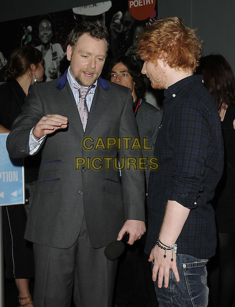 Rufus Hound & Ed Sheeran.BT Digital Music Awards held at the Roundhouse, Chalk Farm, London, England..September 29th 2011.half length black red beard facial hair blue shirt hand arm grey gray suit mouth open goatee .CAP/CAN.©Can Nguyen/Capital Pictures.