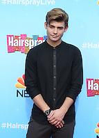 UNIVERSAL CITY, CA - NOVEMBER 16: Garrett Clayton attends the press junket for NBC's 'Hairspray Live!' at the NBC Universal Lot on November 16, 2016 in Universal City, California (Credit: Parisa Afsahi/MediaPunch).