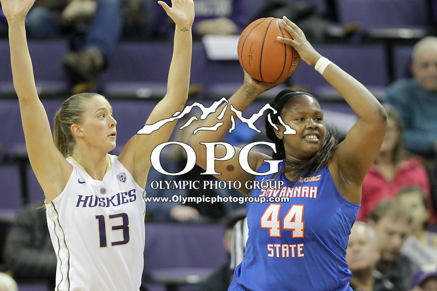 SEATTLE, WA - DECEMBER 18: Washington's #13 Katie Collier blocks out against Savannah State's #44 Tiyonda Davis.  Washington won 87-36 over Savannah State at Alaska Airlines Arena in Seattle, WA.