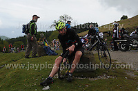 Competitors climb the challenging iconic and notorious 6km 10% stretch of road namely The Tumble during the Wales Velothon 2016 140km route cycling race. Emergency repairs to a broken wheel. <br /> <br /> <br /> Jeff Thomas Photography -  www.jaypics.photoshelter.com - <br /> e-mail swansea1001@hotmail.co.uk -<br /> Mob: 07837 386244 -