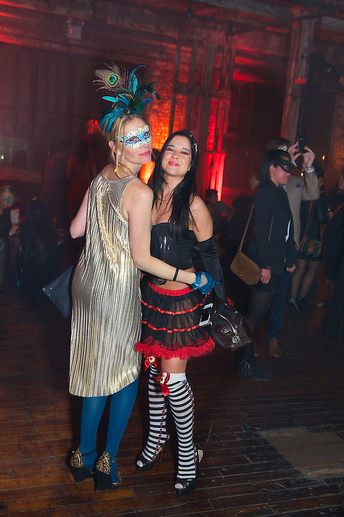 Costumed guests dancing at a Halloween party sponsored by Veuve Clicquot Champagne