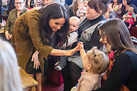 06/11/2019 - Meghan Markle Duchess of Sussex, with a child from the family of a soldier in The Welsh Guards, during a visit to Broom Farm Community Centre in Windsor. The Duke and Duchess of Sussex attended a coffee morning with families of deployed Army personnel at the Centre. Photo Credit: ALPR/AdMedia