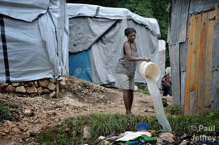 "A woman living in a ""tent city"" of homeless earthquake survivors in the Bobin neighborhood of Port-au-Prince, Haiti. The January 2010 earthquake ravaged the capital, killing some 300,000 people and leaving more than 1.3 million homeless."