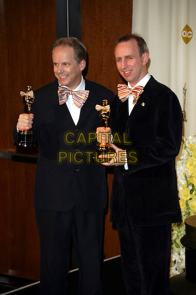 NICK PARK & STEVE BOX.The 78th Annual Academy Awards - Press Room, held at the Kodak Theatre, Los Angeles, California, USA. .March 5th, 2006.Photo: Russ Elliot/Admedia/Capital Pictures.Ref: RE/ADM.Oscar Oscars half length award trophy black suit multicoloured bow ties blue .www.capitalpictures.com.sales@capitalpictures.com.© Capital Pictures.