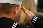 A sailor salutes during a Veterans Day Ceremony