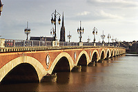 The historic Pont de Pierre crossing over the Garonne River, in the City of Bordeaux, France