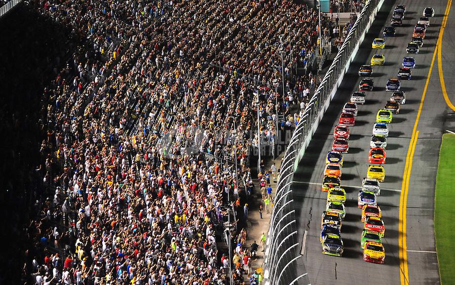 Jul. 3, 2010; Daytona Beach, FL, USA; NASCAR Sprint Cup Series drivers Jimmie Johnson (48) and Kevin Harvick (29) lead the field to the green flag during the Coke Zero 400 at Daytona International Speedway. Mandatory Credit: Mark J. Rebilas-