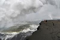 Hikers, lava flow at the Waikupanaha ocean entry, Hawaii, Big Island of Hawaii
