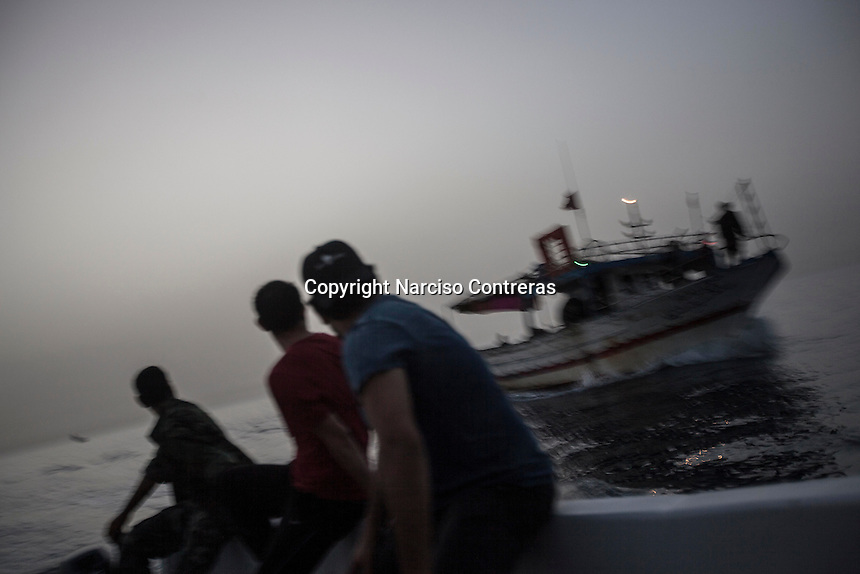 The coastguard escorts a boat to the Zawiyah shore after it was intercepted during a surveillance operation in the west of Libya.