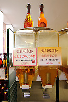 Drinking vinegar for tasting, Oak's Heart vinegar shop, Tokyo, Japan, November 16 2009.