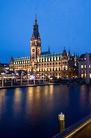 Hamburg Rathaus at night reflected in the lake waters, Town hall,Hamburg, Germany