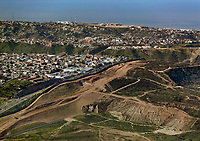 aerial photograph of the United States Mexico border near the Pacific Ocean, San Diego County, California.  A portion of  Tijuana, Mexico. is at the right.