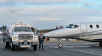 Flight instructor Peggy Bakker fuels Beech 390 Premier 1 jet aircraft at the Petaluma Municipal Airport, Petaluma, Sonoma County, California.
