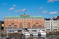 The Grand Hotel luxury hotel with white archipelago cruising boats moored in front Stockholm, Sweden, Sverige, Europe