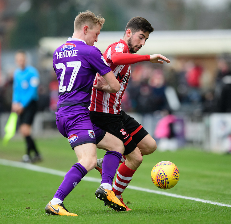 Lincoln City's Tom Pett vies for possession with Grimsby Town's Luke Hendrie<br /> <br /> Photographer Chris Vaughan/CameraSport<br /> <br /> The EFL Sky Bet League Two - Lincoln City v Grimsby Town - Saturday 19 January 2019 - Sincil Bank - Lincoln<br /> <br /> World Copyright &copy; 2019 CameraSport. All rights reserved. 43 Linden Ave. Countesthorpe. Leicester. England. LE8 5PG - Tel: +44 (0) 116 277 4147 - admin@camerasport.com - www.camerasport.com